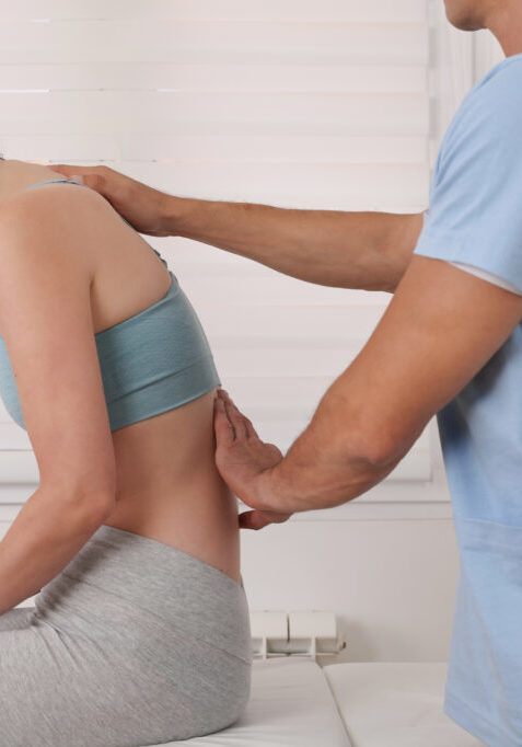 Chiropractic treatment, Back pain relief. Physiotherapy / Kinesiology for female patient. Scoliosis, Posture Correction.
